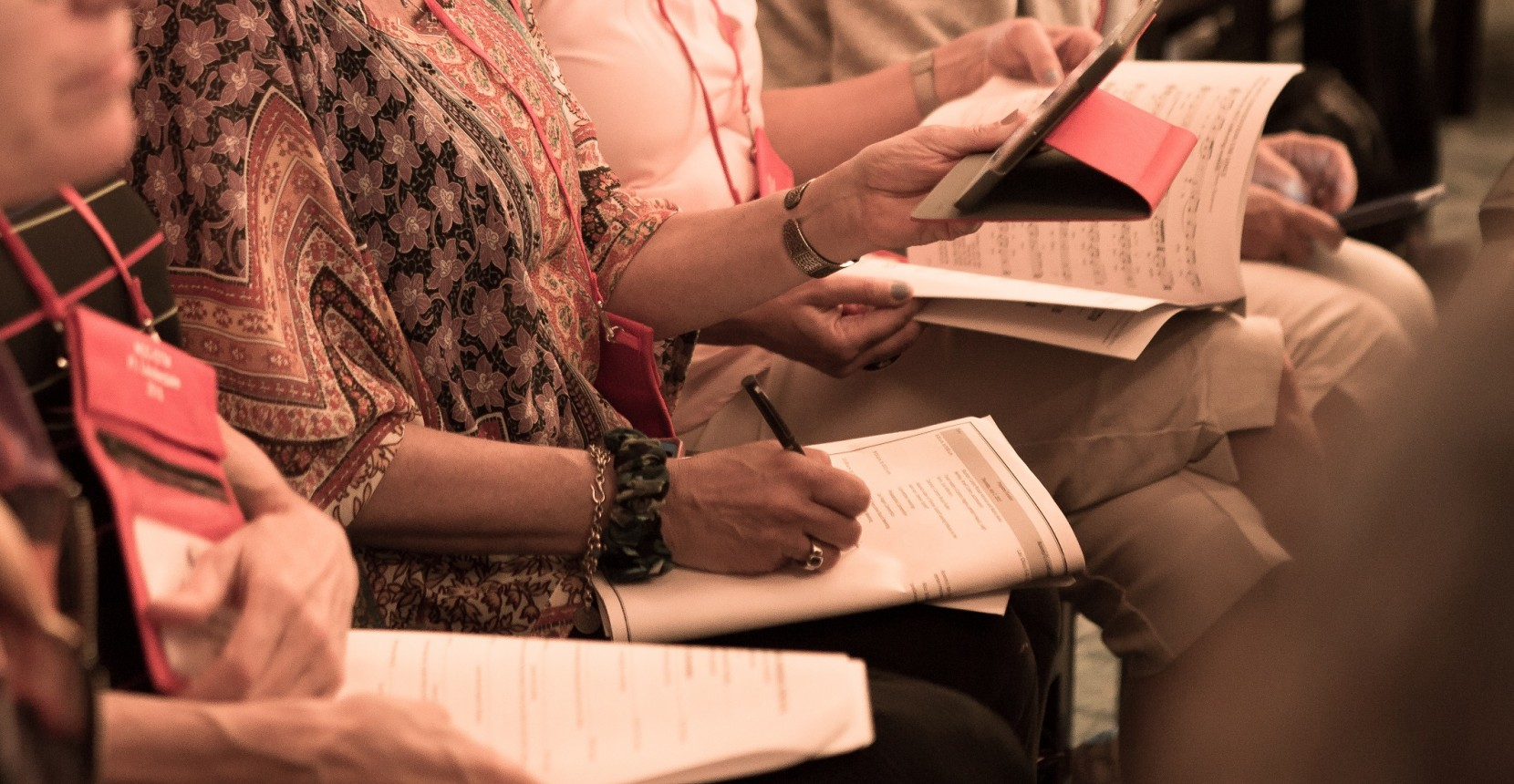 Cantors looking over materials at the annual convention